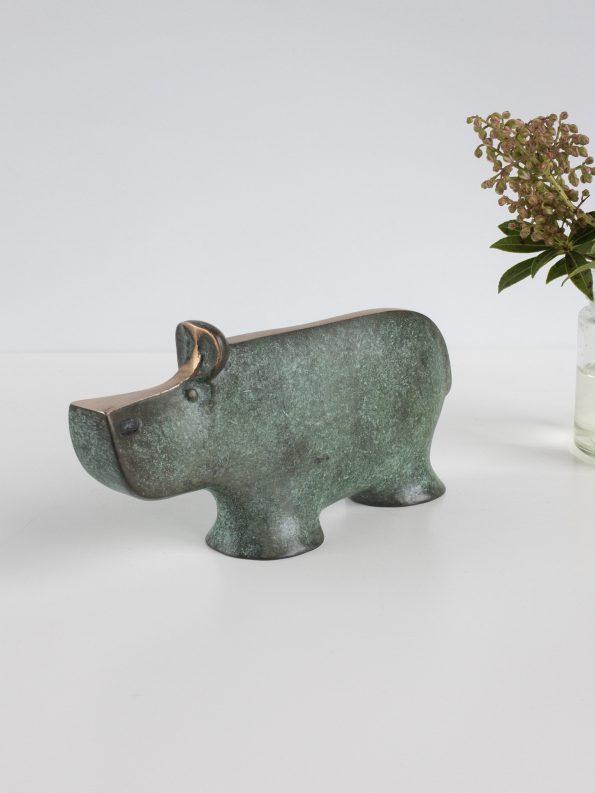 FLODÄSTEN - äkta brons