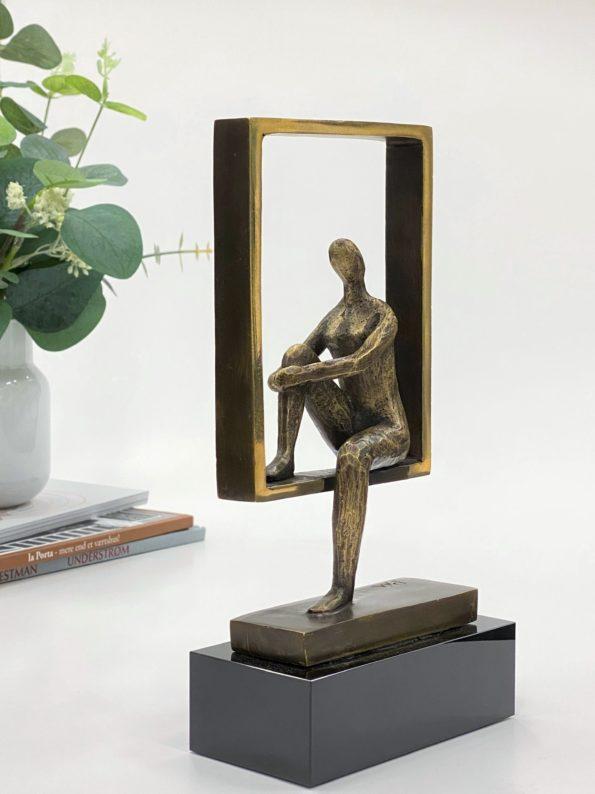 I balans - äkta brons